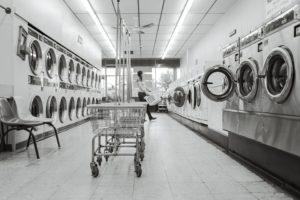 black and white photo of laundromat